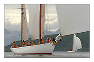 Belle Adventure, a 94' Bermudan Ketch built by Wm Fife in 1929 cruising down the Clyde with Arran's hills appearing in the background. ..This the largest gathering of classic yachts designed by William Fife returned to their birth place on the Clyde to participate in the 2nd Fife Regatta. 22 Yachts from around the world participated in the event which honoured the skills of Yacht Designer Wm Fife, and his yard in Fairlie, Scotland...Marc Turner / PFM Pictures..