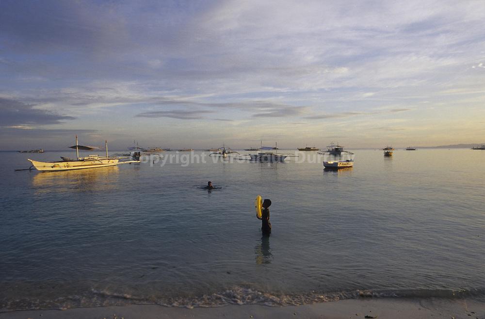 BATH IN ALONA  BEACH , PANGLAO, BOHOL ISLAND, THE PHILIPPINES