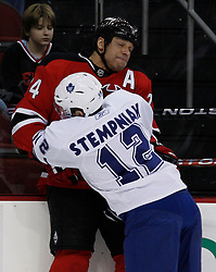 Feb 5, 2010; Newark, NJ, USA; Toronto Maple Leafs right wing Lee Stempniak (12) hits New Jersey Devils defenseman Bryce Salvador (24) during the first period at the Prudential Center.