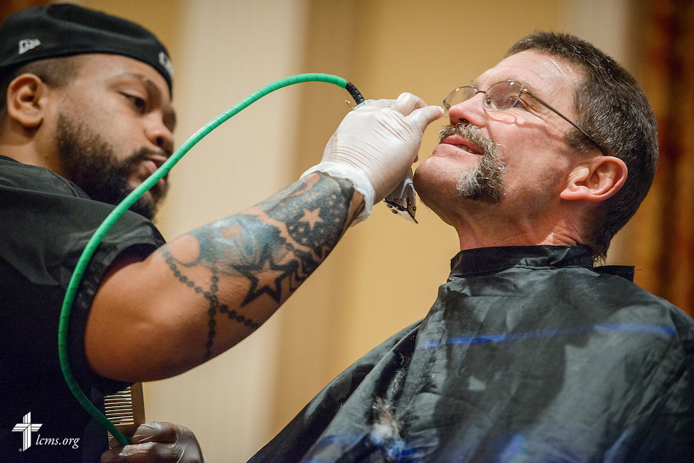 """The Rev. Terry R. Forke, president of Montana District, sits through a shave during """"the Great Mustache Shave Off"""" at the Liberty National LCMS Campus Ministry Conference on Wednesday, Jan. 4, 2017, at the University of Maryland in College Park, Md. LCMS Communications/Erik M. Lunsford"""