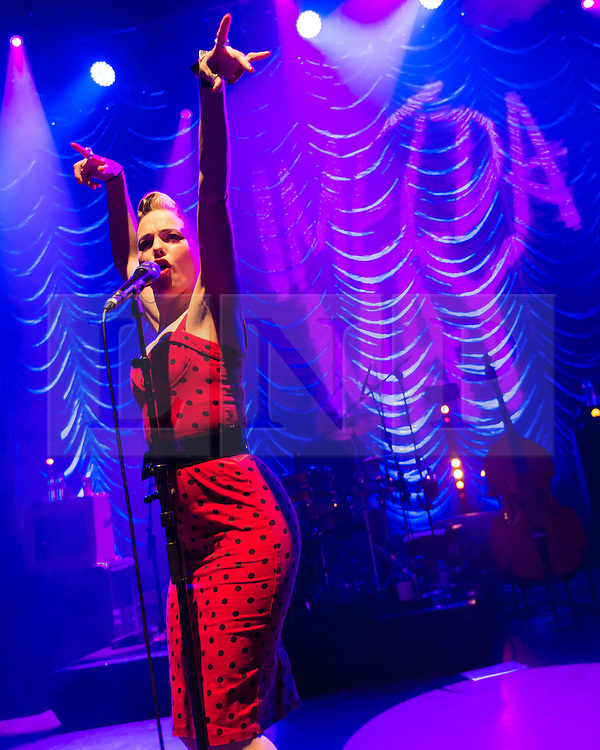 © Licensed to London News Pictures. 24/11/2014. London, UK.   Imelda May performing live at Shepherds Bush Empire.    Imelda May, is an Irish musician, producer and singer-songwriter known for her musical style of rockabilly revival and has also been compared to female jazz musicians such as Billie Holiday.  Photo credit : Richard Isaac/LNP
