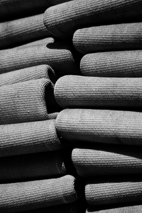 Folded fire hose (attack hose) on the back of a Vienna Volunteer Fire Department truck parked in the sun, Vienna, Virginia.