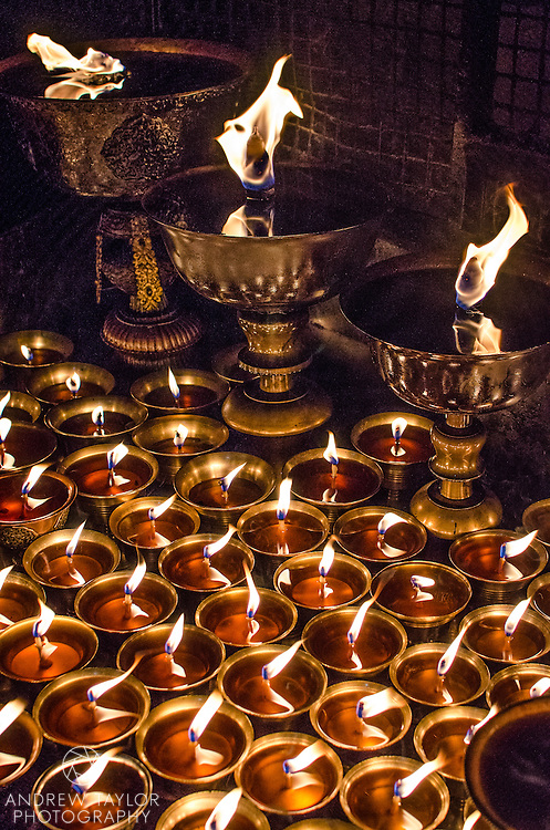 Butter lamps lit for the full moon celebration, Bodhnath stupa, Nepal