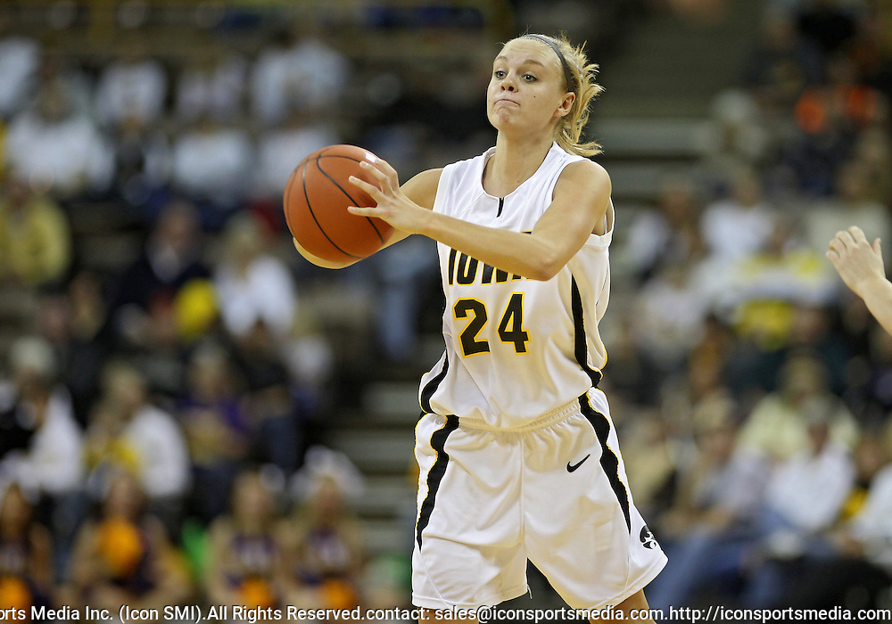 December 22 2010: Iowa guard Jaime Printy (24) passes the ball during the first half of an NCAA college basketball game at Carver-Hawkeye Arena in Iowa City, Iowa on December 22, 2010. Iowa defeated Northern Iowa 75-64.