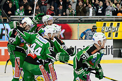 Players celebrate Ales Music (HDD Tilia Olimpija, #16) game-winning goal for lead 4:3 and advancing to semifinal during ice-hockey match between HDD Tilia Olimpija and SAPA Fehervar AV19 at sixth match in Quarterfinal  of EBEL league, on March 1, 2012 at Hala Tivoli, Ljubljana, Slovenia. HDD Tilia Olimpija won 4:3 and advanced to semifinal. (Photo By Matic Klansek Velej / Sportida)