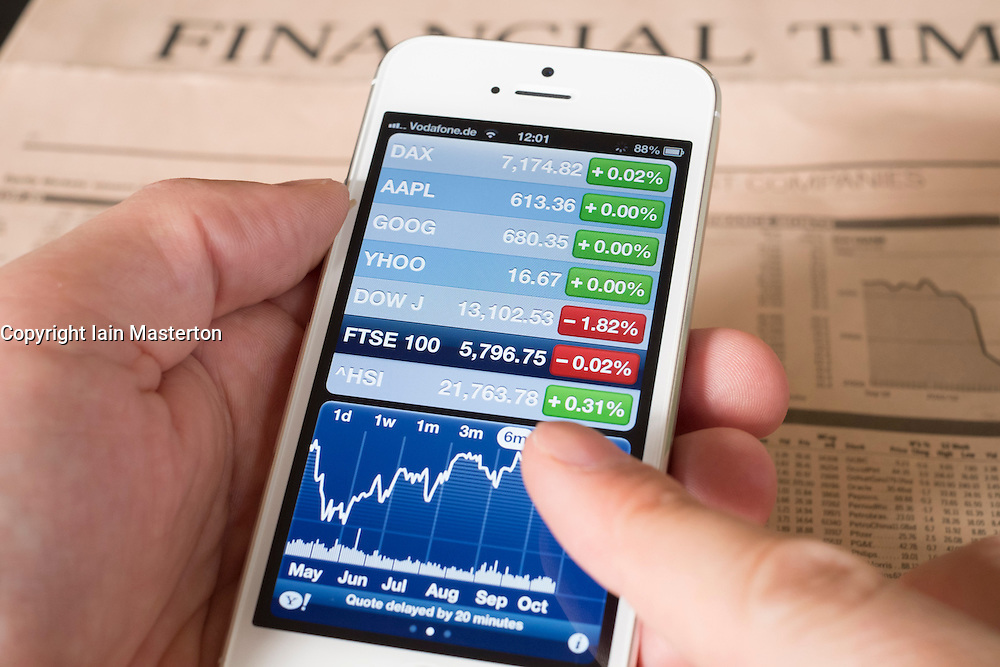 Detail of iPhone 5 smart phone screen showing financial app with FTSE stock market data