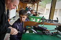 Brady Rinaldi, 17, and his father Steve look over notes after firing off a few rounds Friday at the Coeur d'Alene Rifle & Pistol Club range in preparation for this weekend's opening of hunting season.