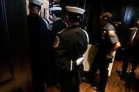 Members of The DeKalb County Fire Dept. color guard at The Spotted Dog--which used to house Fire Station 11--before the start of a commemoration to mark the 60th anniversary of the Winecoff Hotel fire in downtown Atlanta. The fire--at 119 deaths, the worst hotel fire in U.S. history--caused departments across the country to update their safety codes.
