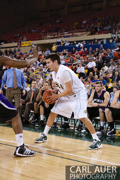 November 25th, 2010:  Anchorage, Alaska - University of Alaska-Anchorage guard Drew Robinson (1) looks to pass in the Seawolves 54-86 loss to Weber State in the first round of the Great Alaska Shootout.
