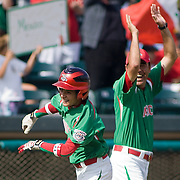 8/22/10 Aberdeen, MD: Mexico short stop Luis Urias (9) celebrate with Mexico Manger Victor Paez Zatarin after Urias blast a home-run in the bottom of the fourth inning scoring Santa Cruz and Moreno at The Cal Ripken World Series in Aberdeen MD. Credit: Saquan Stimpson/ Southcreek Global