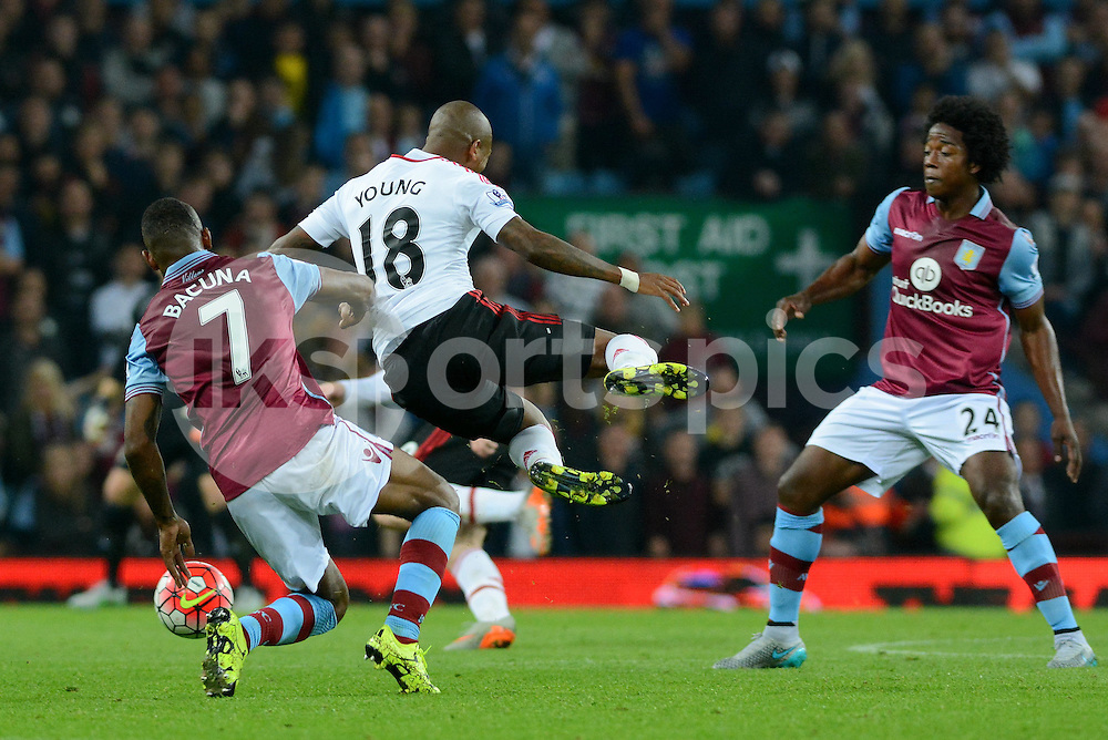 Aston Villa's Leandro Bacuna tackles Manchester United's Ashley Young during the Barclays Premier League match between Aston Villa and Manchester United at Villa Park, Birmingham, England on 14 August 2015. Photo by Garry Griffiths.