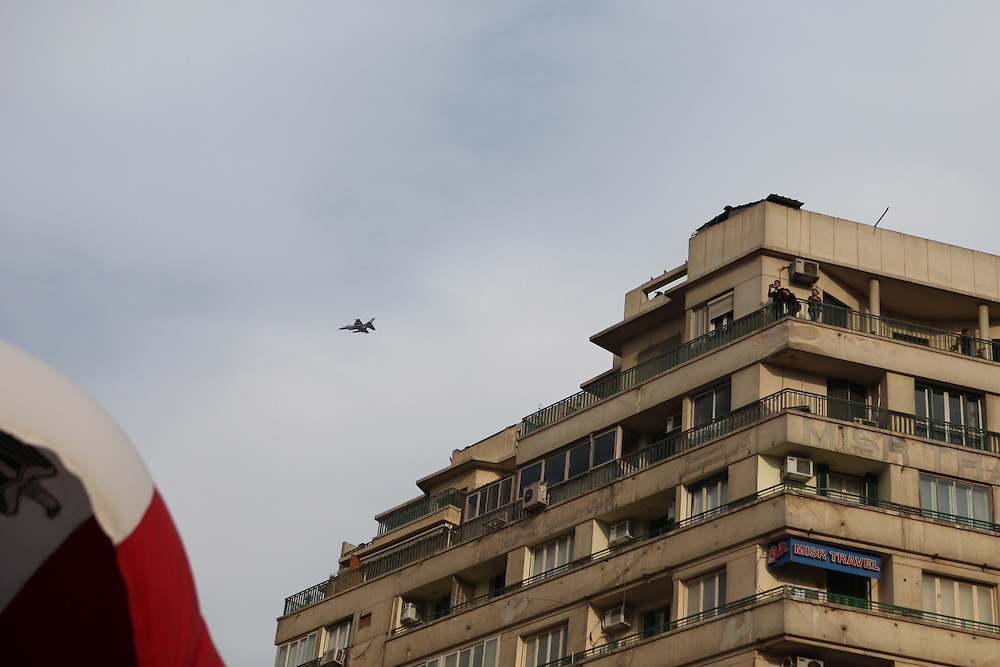 At Cairo's main Tahrir (Liberation) Square an Egyptian army fighter-jet flies overhead.