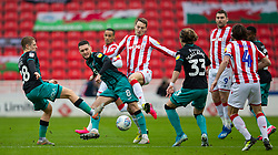STOKE-ON-TRENT, ENGLAND - Saturday, January 25, 2020: Swansea City's captain Matt Grimes (L) and Stoke City's Nick Powell during the Football League Championship match between Stoke City FC and Swansea City FC at the Britannia Stadium. (Pic by David Rawcliffe/Propaganda)