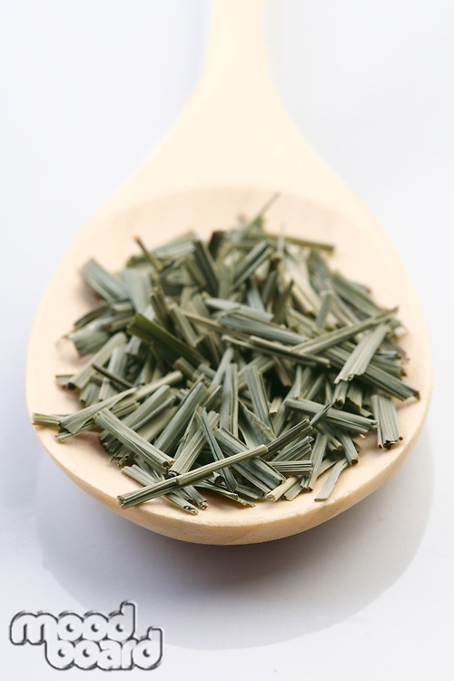 Dried lemon grass on wooden spoon