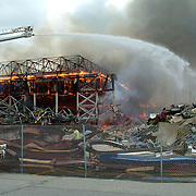 NAS BRUNSWICK,  Brunswick, Maine -- June 13, 2007.Hangar One on the base burned today at NAS Brunswick. The hangar, built in 1942, had been deserted for two years and was in the process of being demolished. The cause of the blaze is yet to be determined. Crews from as far away as Freeport and Woolwich came to assist.  Photo by Roger S. Duncan. (PHOTO RELEASED BY NAS BRUNSWICK PUBLIC AFFAIRS ) ..