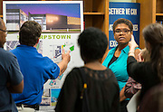 Houston ISD staff and representatives from Munoz architects and KBR discuss updates to the plan for the new Sharpstown High School, September 23, 2014.