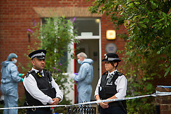© Licensed to London News Pictures. 27/07/2015. London, UK. A jacket lying on the floor in the grounds of the property. Police and scene of crime officers at Colette House in Acton, West London, where the body of a woman in her 30s was found this morning (Mon). Police are currently searching for Michael Meanza  aged 47 in connection work the death.  Photo credit: Ben Cawthra/LNP