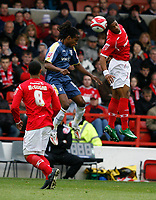 Photo: Richard Lane/Richard Lane Photography. Nottingham Forest v Cardiff City. Coca Cola Championship. 24/10/2008. James Perch (R) and Miguel Comminges (C) in the air