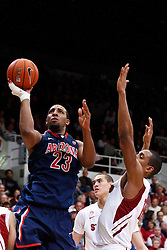 February 3, 2011; Stanford, CA, USA;  Arizona Wildcats forward Derrick Williams (23) shoots past Stanford Cardinal forward/center Josh Owens (13) during the second half at Maples Pavilion.  Arizona defeated Stanford 78-69.