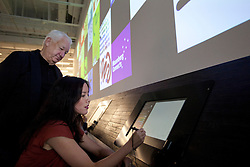© Licensed to London News Pictures. 19/09/2013. London, UK. Watched by fellow artist Michael Craig-Martin, Gail Chong Kwan uses a touch screen to draw art at the press launch of 'Make Your Mark on Tate Modern' at the gallery in London today (19/09/2013). The new interactive feature allows artists and members of the public to create art and then post it to the on one of the 75 display screens, the created art is then archived by the gallery. Photo credit: Matt Cetti-Roberts/LNP