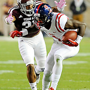Mississippi wide receiver Laquon Treadwell (1) looks for room past a Texas A&M defender during the first half of an NCAA college football game in College Station, Texas, Saturday, Oct. 11, 2014. (Photo/Thomas Graning)