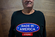 Standing in front of a mural of the United States Constitution, Richard Andol Sr., father of store owner Mark Andol, wears one of the Made in America store's t-shirts. Linda McMahon, Administrator of the Small Business Administration, visited the store in Elma, New York on Friday, January 19, 2018.