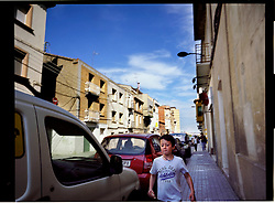 2012.Binefar, Huesca, Spain.A child running down the street.© Carmen Secanella