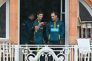Tim Paine of Australia on the team balcony with Justin Langer as the rain finaly stops during the International Test Match 2019 match between England and Australia at Lord's Cricket Ground, St John's Wood, United Kingdom on 14 August 2019.