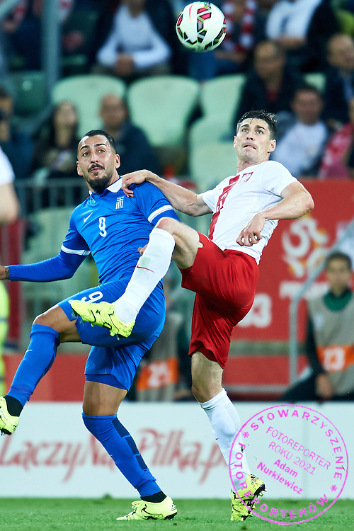 (R) Marcin Komorowski from Poland fights for the ball with (L) Kostas Mitroglou from Greece during international friendly soccer match between Poland and Greece at PGE Arena Stadium on June 16, 2015 in Gdansk, Poland.<br /> Poland, Gdansk, June 16, 2015<br /> <br /> Picture also available in RAW (NEF) or TIFF format on special request.<br /> <br /> For editorial use only. Any commercial or promotional use requires permission.<br /> <br /> Adam Nurkiewicz declares that he has no rights to the image of people at the photographs of his authorship.<br /> <br /> Mandatory credit:<br /> Photo by &copy; Adam Nurkiewicz / Mediasport
