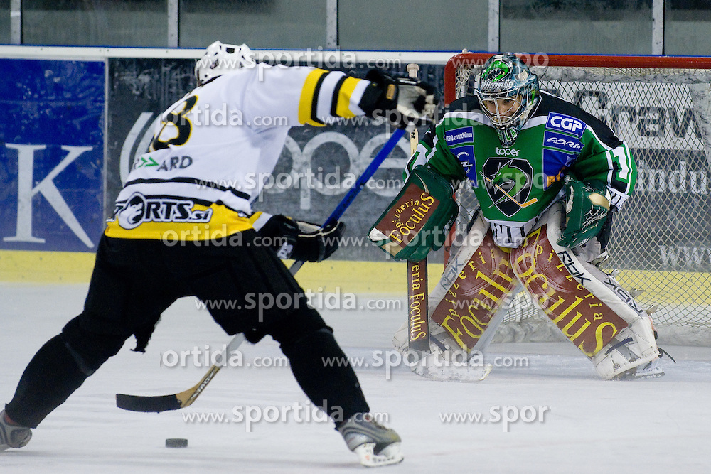 Jure Vnuk fakes out goalie Ales Sila and scores on a breakaway in Tomaz Vnuk's exhibition game between team HDD Tilia Olimpija and team 24 Ever on August 28, in Ljubljana, Slovenia. (Photo by Matic Klansek Velej / Sportida)