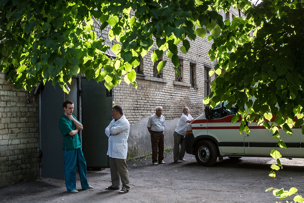 VOLNOVAKHA, UKRAINE - MAY 22:  Doctors stand outside a hospital treating Ukrainian soldiers who were wounded earlier in the day during an attack on a military checkpoint by unknown forces on May 22, 2014 in Volnovakha, Ukraine. Authorities reported fifteen soldiers were killed and 31 injured. (Photo by Brendan Hoffman/Getty Images) *** Local Caption ***