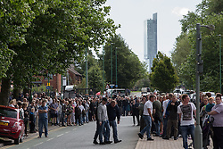 "© Licensed to London News Pictures . 28/08/2015 . Salford , UK . People on Churchill Way as the procession approaches . The funeral of Paul Massey at St Paul's CE Church in Salford . Massey , known as Salford's "" Mr Big "" , was shot dead at his home in Salford last month . Photo credit : Joel Goodman/LNP"