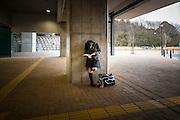 JAPAN, TOKYO, FEBRUARY 2013 -  Woman in metro station [FR] Femme dans la station de metro