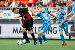 (L-R) Mike van Duinen of Excelsior, Wout Droste of Heracles Almelo, Peter van Ooijen of Heracles Almelo during the Dutch Eredivisie match between sbv Excelsior Rotterdam and Heracles Almelo at Van Donge & De Roo stadium on April 18, 2018 in Rotterdam, The Netherlands