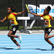 A baton change during a girls 4x100m relay race during the Diamond League Adidas Grand Prix at Icahn Stadium, Randall's Island, Manhattan, New York, USA. 13th June 2015. Photo Tim Clayton