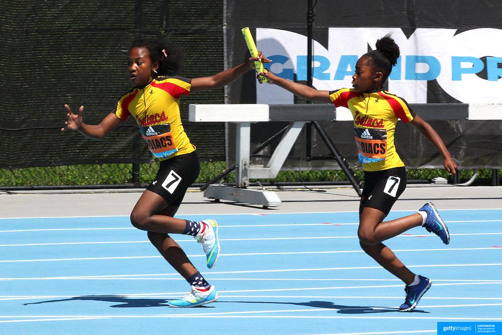 A baton change during a girls 4x100m relay race during the Diamond League Adidas Grand Prix at Icahn Stadium, Randall's Island, Manhattan, New York, USA. 13th June 2015. Photo Tim Clayton
