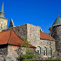 Akershus Fortress in Norway at Epcot in Orlando, Florida<br /> Another fa&ccedil;ade of the 58,000 foot Norway Pavilion was inspired by Akershus Festning. The original fortress was built in 1299 and is still standing behind a protective stone wall along the Oslo Fjord. Inside this Epcot attraction you will feel like you are walking the cobblestone streets of a Norwegian village. Surrounding you are architectural features of landmarks from several towns. This pavilion is the youngest at Epcot. Norway opened in 1988.
