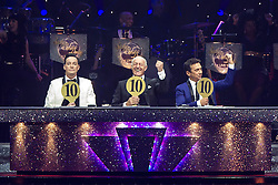 © Licensed to London News Pictures . 31 January 2013 . Manchester Arena , Manchester , UK . L-R Craig Revel Horwood , Len Goodman , Bruno Tonioli give Lisa Riley and Robin Windsor a perfect 10 . Strictly Come Dancing on tour . Photo credit : Joel Goodman/LNP