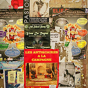 Posters on a wall in Nice, France.