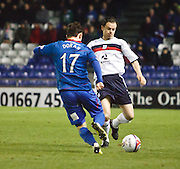 Dundee's Matt Lockwood  tackles Inverness Caledonian Thistle's Aaron Doran  - Inverness Caledonian Thistle v Dundee, Clydesdale Bank Scottish Premier League at Tulloch Caledonian Stadium, Inverness.. - © David Young - www.davidyoungphoto.co.uk - email: davidyoungphoto@gmail.com