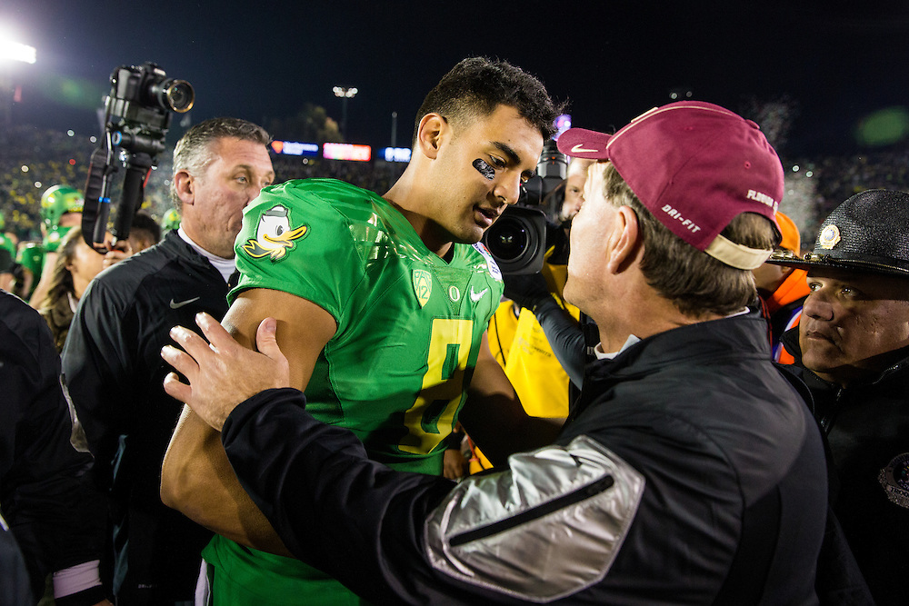 Marcus Mariota, Quarterback, University of Oregon, and Jimbo Fisher, head Coach, Florida State University. Photographed at the 2015 Rose Bowl Game in Pasadena, California, on January 1, 2015. (Photograph ©2015 Darren Carroll)