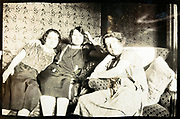 deteriorating image of woman sitting indoors 1930s