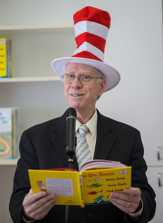 "Houston ISD Food Services Administration's Ray Danilowicz reads, ""One Fish Two Fish Red Fish Blue Fish"" to students celebrating Dr. Seuss Day and National Reading Day at the Rice School, March 3, 2014."