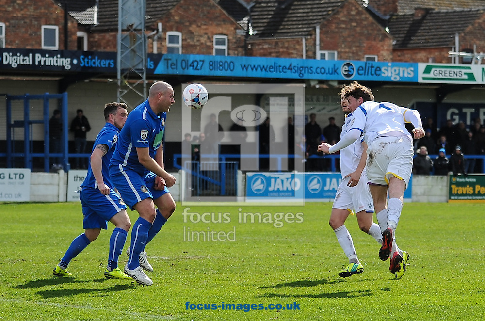 Michael Spillane of Lowestoft Town heads on goal during the National League North match at the Northolme, Gainsborough<br /> Picture by Richard Land/Focus Images Ltd +44 7713 507003<br /> 16/04/2016