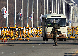 A South Korean soldier stands guard at the Unification Bridge near the Customs, Immigration and Quarantine (CIQ) office in Paju, Gyeonggi province of South Korea, April 10, 2013. South Korea is seeing the warning by the Democratic People s Republic of Korea (DPRK) to foreigners in Seoul to consider evacuation as psychological warfare, the presidential office said Tuesday, April 10, 2013. Photo by Imago / i-Images...UK ONLY.