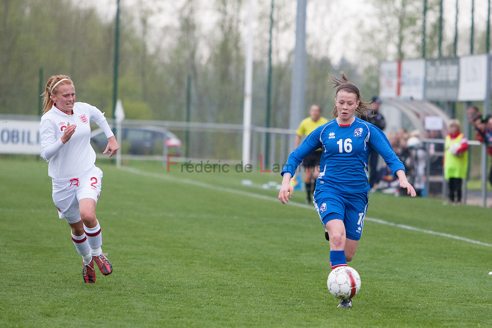 21120413 - IEPER, BELGIUM : Iceland's  Sandra Jessen (16)  carrying the ball is chased by England's  Molly Bartrip (2)  during the Second qualifying round of U17 Women Championship between England and Iceland on Friday April 13th, 2012 in Ieper, Belgium.