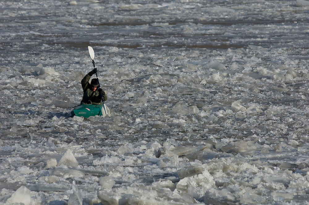 Steven Antonacci rows his kayak across the jagged frozen surface of the water toward his riverside home near Chillicothe, Illinois. ©David Zalaznik