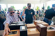 Vernon Farley of Delaware salutes as an unidentified man places his hand on the boxes containing the veterans remains during burial services with full military honors, held for 12 veterans left unattended by family or friends Thursday, August 29, 2019 at Washington Crossing National Cemetery in Washington Crossing, Pennsylvania. Once a month, burials are held for veterans who have no family and their remains have never been claimed. Some vets remains have waited 12 years for burial. (Photo by William Thomas Cain / CAIN IMAGES)
