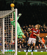 Marcus Bettinelli of Fulham tips the ball over the cross bar under pressure from Craig Mackail-Smith of Brighton and Hove Albion during the Sky Bet Championship match at Craven Cottage, London<br /> Picture by David Horn/Focus Images Ltd +44 7545 970036<br /> 29/12/2014