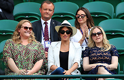 Duchess of Sussex watching Serena Williams on court one on day four of the Wimbledon Championships at the All England Lawn Tennis and Croquet Club, Wimbledon.